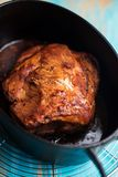 Slow cooked pork. Slowed cooked pork in a cast iron pot, before being shredded for pulled pork Royalty Free Stock Images