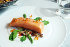 Slow Cooked Salmon fillet steak with salad and roe salmon on white plate. Sous-Vide Cooking Salmon Fish Stock Photos