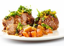 Slow cooked shin beef with orange gremolata Stock Photos