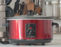 Slow Cooker. Close up of a slow cooker working on kitchen shelf royalty free stock photos