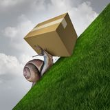 Slow Delivery Service. Slow delivery and package shipping as a snail pushing a cardboard box parcel up ahill as a postal service concept with 3D illustration Stock Photo