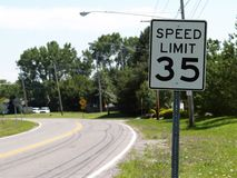 Slow Down... 35 MPH Speed Limit Sign in a small town stock photography