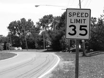 Slow Down... (B&W). 35 MPH Speed Limit Sign in a small town (B&W stock photos