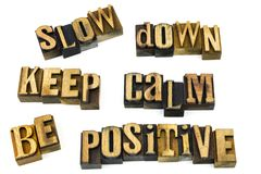 Slow down calm positive letterpress. Words letters slow down keep calm be positive concept message letterpress wooden blocks quote inspirational Stock Photo