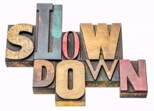 Slow down word abstract in wood type royalty free stock photo