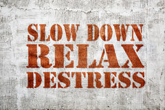 Slow down, relax and destress graffiti Stock Photo