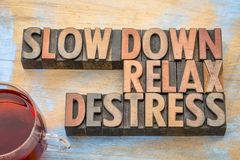 Slow down, relax, destress word abstract in wood type. Slow down, relax, destress  word abstract in vintage letterpress wood type Stock Images