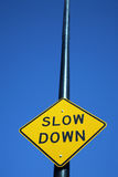 Slow down sign. Traffic sign that says slow down stock images