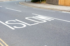 Slow down sign painted on road Royalty Free Stock Photos