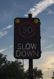Slow down sign. A slow down sign warning drivers of the speed limit royalty free stock image