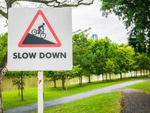 Slow Down Sign For Way Down in a Park. Warning Sign For Way down stock images
