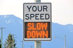 Slow Down Traffic Sign. Close on an electronic sign that displays a message to slow down when the motorist or driver is traveling an unlawful speed stock image