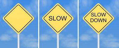 Slow down traffic signs. Three yellow traffic or road signs with the words slow and down and one blank.  Blue sky background Royalty Free Stock Photos