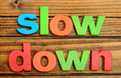 Slow Down word on table Royalty Free Stock Images