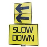 Slow Down yellow road sign isolated on white. Arrows royalty free stock photo