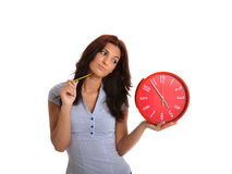 Slow Ending Time. Business woman looking to the time that does not pass royalty free stock image