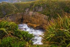 Surge Pool. Slow Exposure Of Waves Crashing Into A Surge Pool, Pancake Rocks, Punakaisi, Paparoa National Park, South Island, New Zealand stock image