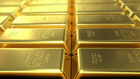 Slow flight over gold bars stock footage