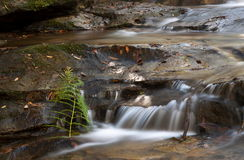 Slow flowing waterfall. Clear flowing water cascades over the rocks in the Blue Mountains stock images