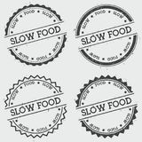 Slow food insignia stamp isolated on white. Slow food insignia stamp isolated on white background. Grunge round hipster seal with text, ink texture and splatter Stock Photo