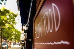 Slow food sign in Barcelona. Slow food sign on a wall in Barcelona - Spain stock image