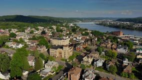 Slow Forward Aerial Approach to Pennsylvania Small Town Business District. A slow forward aerial approach to the business district of a small Pennsylvanian town stock video footage