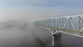 Forward Aerial View of Bridge Over Ohio River in Fog stock footage