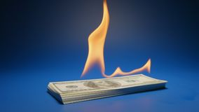 Slow motion: heap of paper money us dollar flaming on a table. Slow: heap of paper money us dollar flaming stock video