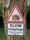 Slow Hedgehogs Crossing Sign. Warning wildlife caution driving preservation safety stock image