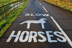 Slow horses. Slow down,horses on road sign,Warwickshire college,England Royalty Free Stock Photography