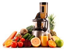 Slow juicer with organic fruits and vegetables on white Royalty Free Stock Photography