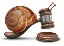 Slow Justice. Law concept as a gavel or mallet shaped as a sluggish snail shell hitting a sounding block as a symbol of problems with legal system sentencing Stock Photos