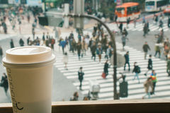 Slow life, Coffee time in rush hour of Big City, blur of people Stock Photos