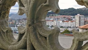 Slow looking through the rosettes of the Gothic railing of the Cathedral of Castro Urdiales 22. Slow Motion Dolly Truck Left Gothic fence with rosettes through stock footage