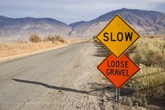Slow Loose Gravel Sign Along Rural Road stock photos