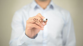 Slow, Man Writing on Transparent Screen Royalty Free Stock Images