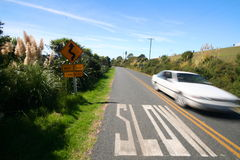 Slow marking on the road and fast car. With speed blurr, Waiheke islnd, new Zealand Royalty Free Stock Photography
