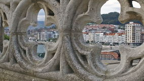 Slow looking through the rosettes of the Gothic railing of the Cathedral of Castro Urdiales 22. Slow Motion Dolly Truck Left Gothic fence with rosettes through stock video footage