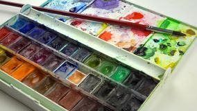 Slow-mo footage. Close up set of colorful watercolors. Dolly shot. Close up set of colorful watercolors. Dolly shot stock video