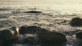 Slow mo large stones in the foreground in water stock footage