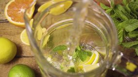 Slow mo made lemonade in the carafe stock video footage