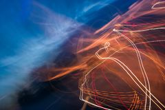 Slow motion abstraction on the road. Blurred background of car light traces and cloudy night sky. traffic wild energy concept Stock Photography