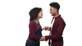Slow motion African American attractivie young couple enjoy dancing in white studio background. Slow motion African American attractivie young couple enjoy stock video footage