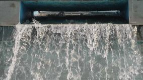 Slow motion of artificial water fall in town centre. Symbol of life and vitality. Time flow. Slow motion of artificial water fall in town centre. Symbol of life stock footage