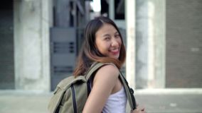 Slow motion - Asian backpacker woman feeling happy traveling in Beijing, China, cheerful beautiful young teenager blogger. stock video