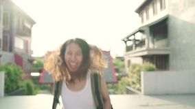 Slow motion - Asian backpacker woman feeling happy traveling in Beijing, China, cheerful beautiful young teenager blogger. stock footage
