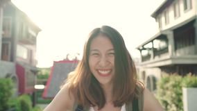 Slow motion - Asian backpacker woman feeling happy traveling in Beijing, China, cheerful beautiful young teenager blogger. stock video footage