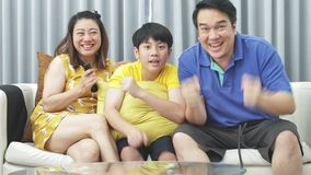 Slow motion of asian family father mother and son on couch, Looking at camera with smile face.  stock video footage