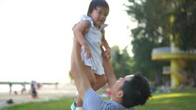 Slow motion of Asian Father and young baby girl stock video footage