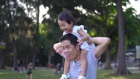 Slow motion of Asian Father and young baby girl stock footage